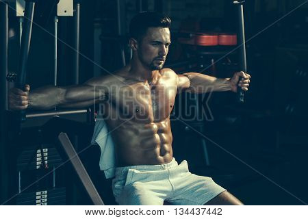 Muscular Man Training In Gym