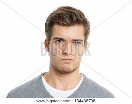 young man making a face. isolated on white background