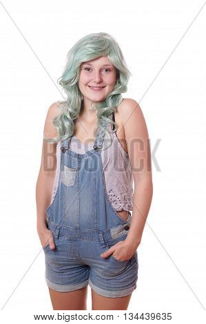 smiling young woman with green hair and jeans dungarees