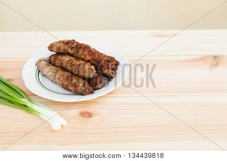 Lamb Kebab On Plate And Onion On Light Wooden Background With Copyspace. Cuisine Background. Eastern