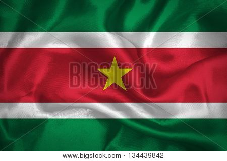 Suriname - Waving national flag on silk texture