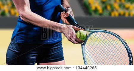 Tennis player holding a racquet ready to serve against composite image of supporter in stadium