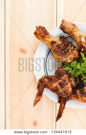 Chicken Wings And Legs On Plate And Onion On Light Wooden Background With Copyspace. Cuisine Backgro