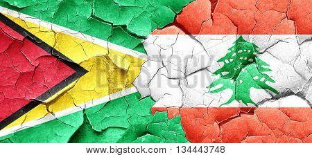 Guyana flag with Lebanon flag on a grunge cracked wall