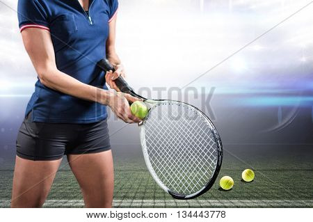 Tennis player holding a racquet ready to serve against american football arena