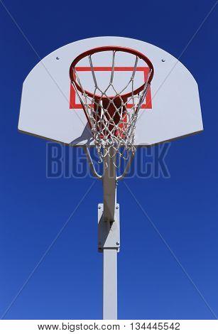 Basketball basket on blue sky background.  durable mesh.
