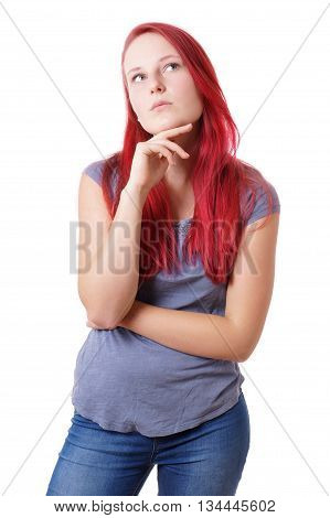 young woman looking up thinking. isolated on white.
