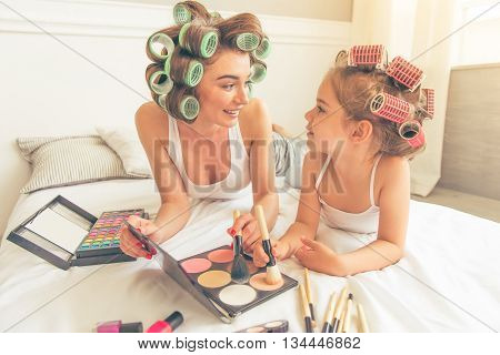 Mom And Daughter At Home