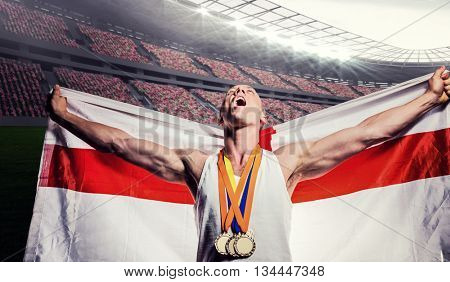 Athlete posing with gold medals after victory against rugby stadium