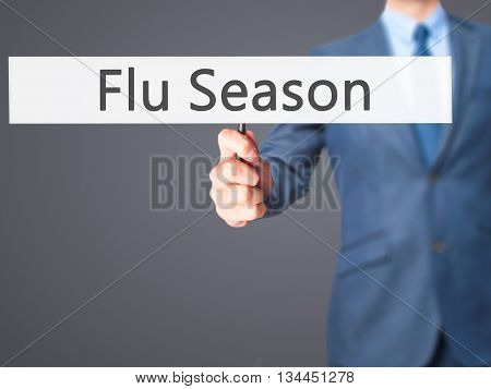 Flu Season - Businessman Hand Holding Sign