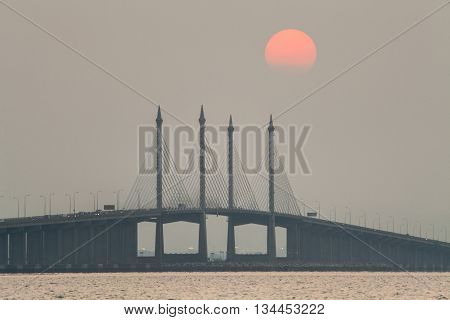 Hazy Sunrise and Sunset in Penang Bridge George Town, Penang Malaysia