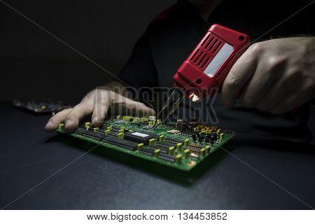 Male hands repairing / fixing computer details