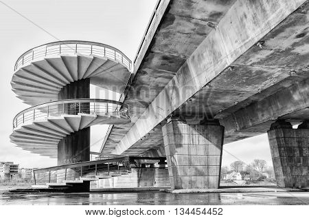 Spiral stairs and bridge. Greyscale. Transportation. Technology