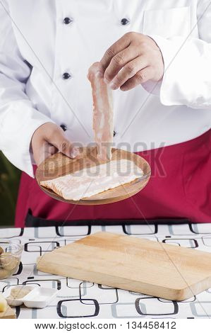 Chef present bacon for cooking spaghetti carbonara / cooking spaghetti concept