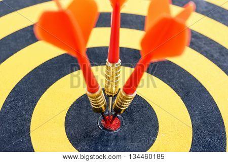 closeup one target with three dart arrows hitting the bullseye (center)(goal). success business teamwork concept, abstract success business background