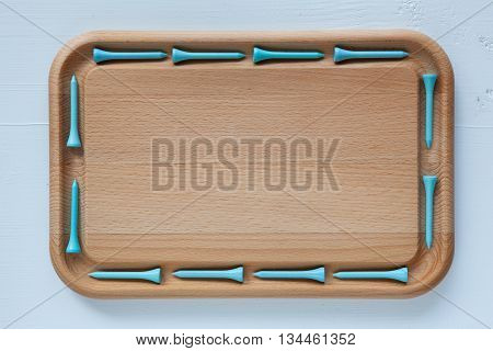 Empty cutting board with different wooden golf tees