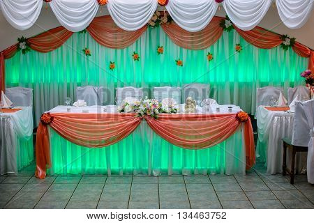 banquet hall in the restaurant with green backlight.