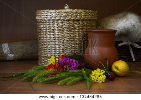 rustic still life-fruit, berries, wild flowers, interesting dishes