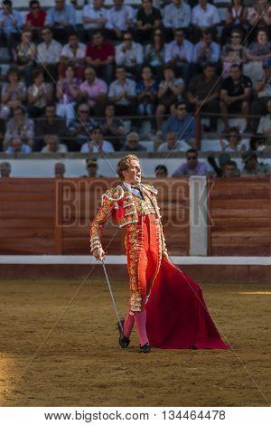 Pozoblanco Spain - September 24 2011: The Spanish Bullfighter Jose Luis Moreno bullfighting with the crutch in the Bullring of Pozoblanco Spain