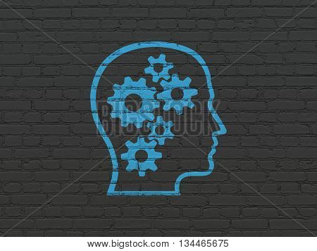 Data concept: Painted blue Head With Gears icon on Black Brick wall background