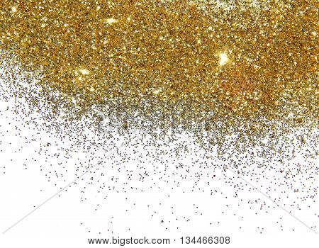 Golden glitter sparkle on the white background