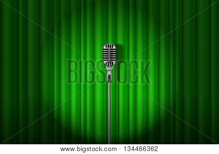 Vintage Microphone against green curtain with spotlight light backdrop