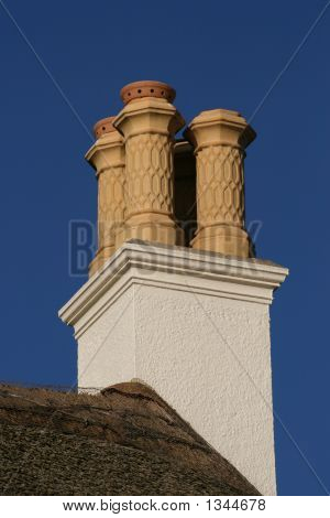 Thatched Roof And Chimneys