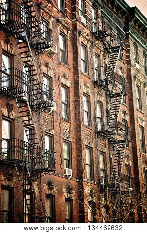 New Your City buildings along a street with fire escapes