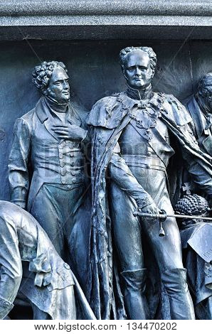 VELIKY NOVGOROD RUSSIA - JUNE 14 2016. Sculptural group Statesmen at the monument Millennium of Russia - sculptures of Alexander I Tsar and Viktor Kochubey Statesman and Diplomat