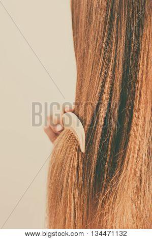 Woman Combing Her Long Hair Closeup