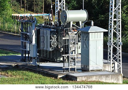 view of modern high voltage transformer at the substation