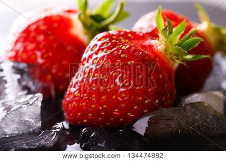 Three Fresh Strawberries On Slate Stone With Ice