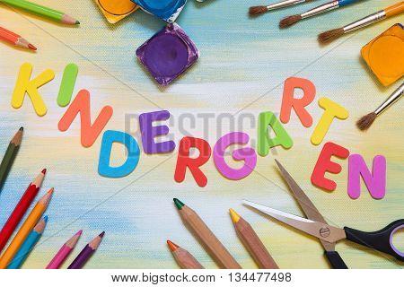 some colorful letters school supplies word kindergarten