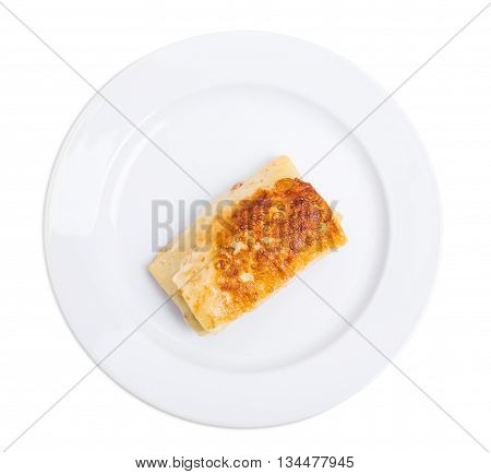 Russian pancake stuffed with pork forcemeat. Isolated on a white background.