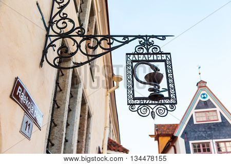 Tallinn Estonia - May 31 2016: signboard of old pharmacy museum of Tallinn on the Town Hall Square in the Historical Center of city. Tallinn Estonia.
