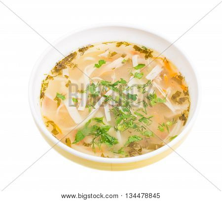 Traditional moldovan chicken soup with noodles and vegetables. Isolated on a white background.