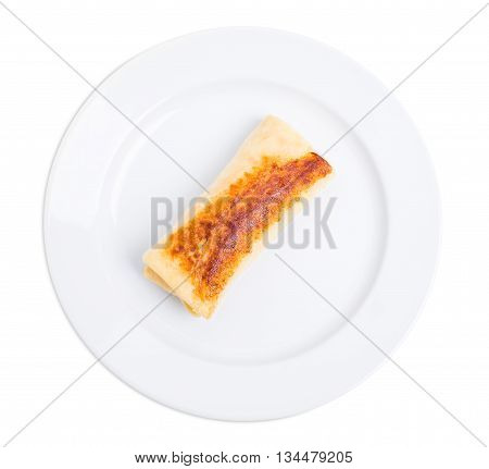 Russian pancake stuffed with cream cheese. Isolated on a white background.