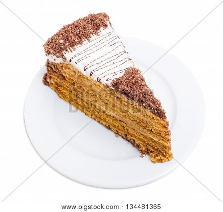 Delicious cake with grated chocolate and walnuts. Isolated on a white background.
