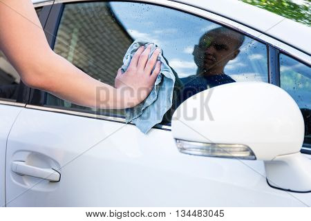 Male Hand With Microfiber Cloth Cleaning Car