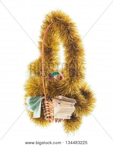 Wicker basket full of euro bills with christmas golden tinsel and bright Christmas ball. Isolated on a white background.