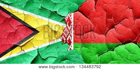 Guyana flag with Belarus flag on a grunge cracked wall