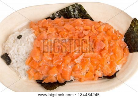 Sliced salmon and rice in form of fish on ceramic plate. Macro. Photo can be used as a whole background.