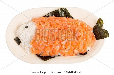 Sliced salmon and rice in form of fish on ceramic plate. Macro. Isolated on a white background.