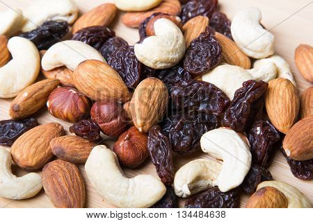 Trail mix on wooden background - healthy food
