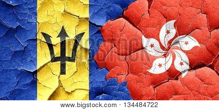 Barbados flag with Hong Kong flag on a grunge cracked wall
