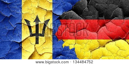 Barbados flag with Germany flag on a grunge cracked wall