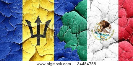 Barbados flag with Mexico flag on a grunge cracked wall