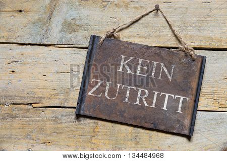 Rusty Metal Sign On Wooden Table, German Text, Concept No Entry