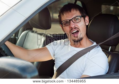 Male stupid face european driver is opening his mouth