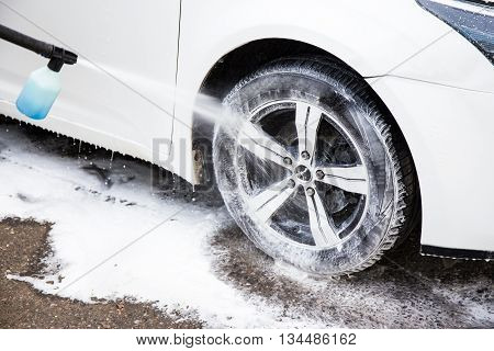 Washing Modern Car With High Pressure Water